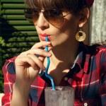 Woman drinking milk shake — Stock Photo #64792443