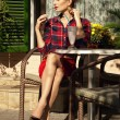 Pretty woman in a cafe — Stock Photo #64794481