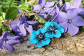 Handmade blue flower clay earrings on the nature background — Foto de Stock