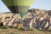 Hot air balloon flying over Cappadocia — Stock Photo