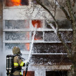 Fireman put out fire with foam — Stock Photo #68352921
