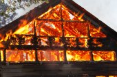 House gable engulfed in flames — Stock Photo