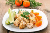 Chicken shish kebab on wooden table — Stock Photo