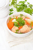 Fish soup with salmon in bowl on white wooden table — Stock Photo