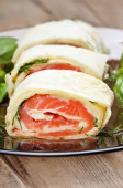 Salmon lavash rolls with cheese and herbs — Stock Photo