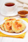 Cheese pancakes, confiture and tea cup — Stock Photo