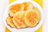 Cheese pancakes on white plate — Stock Photo
