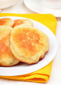 Fritters on white plate, close up view — Stock Photo