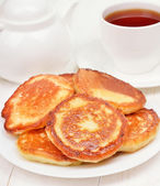 Fritters and tea — Stock Photo
