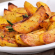 Fried potato wedges on white plate — Stock Photo #61535915