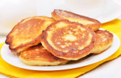 Homemade fritters on white plate — Stock Photo