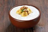 Oatmeal porridge with walnuts and bananas — Stock Photo