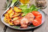 Grilled pork cutlets with baked potatoes — Stock Photo