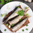 Постер, плакат: Sandwich with sprats on wooden table