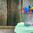 Pens and writing-books on a wooden shelf. — Stock Photo #51912979