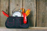 School tools in a case. On wooden background. — Stock Photo