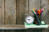 Alarm clock and school accessories . — Foto de Stock