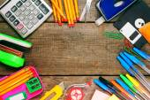 Back to school. School tools around. Wooden background. — Stock Photo