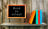Back to school. Books on wooden background. — Stock Photo