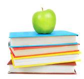 书籍和一个苹果。白色背景上. — 图库照片