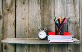 Alarm clock and school accessories . — Stock Photo
