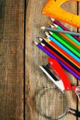 Back to school. School tools around. Wooden background. — Foto de Stock