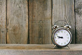 Alarm clock. On wooden background. — Stock Photo