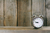 Alarm clock. On wooden background. — Stock Photo