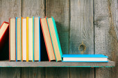 Books on a wooden shelf. — Stock Photo