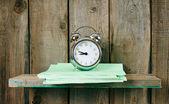 Writing-books and an alarm clock . — Stock Photo