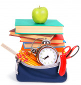 Books, an apple and school tools. — Stock Photo