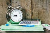 Alarm clock and school accessories. — Stock Photo