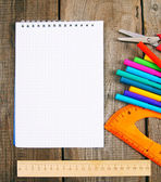Notebook and school tools around. — Stock Photo