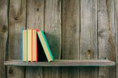 Books on a wooden shelf. — 图库照片
