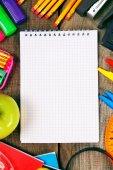 Notebook and school tools around. — Stock Photo