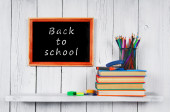 Books and school tools on wooden shelf. — Stock Photo