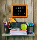 Writing-books, an apple and school tools. — ストック写真