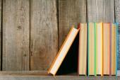 Books on a wooden shelf. — Stock Photo