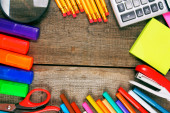 Back to school. School tools around. Wooden background. — Stock Photo