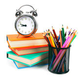 Books, an alarm clock and school tools. — Stock Photo