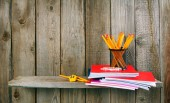 School accessories. On wooden background. — Stock Photo