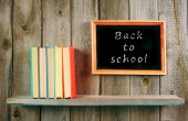 Back to school. Books on wooden shelf and frame. — Stock fotografie