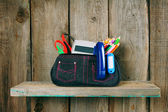 School tools in a case. On wooden background. — Photo
