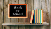 Back to school. Books on wooden background. — Photo