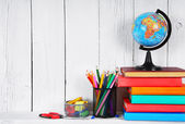 Books and school tools on a wooden shelf. — Stock Photo