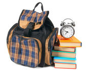 School backpack, books and alarm clock. — Photo