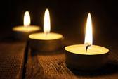 Burning candles. On wooden background. — Stock Photo