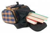 School backpack and books. On white background. — Stock Photo