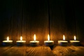 Burning candles. On wooden background. — Stock Photo