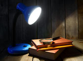 The fixture, books and a magnifier. — Stock Photo